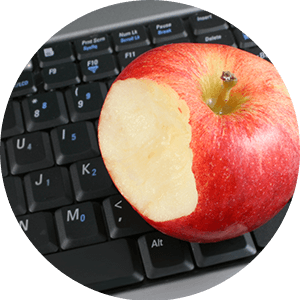Apple on computer keyboard