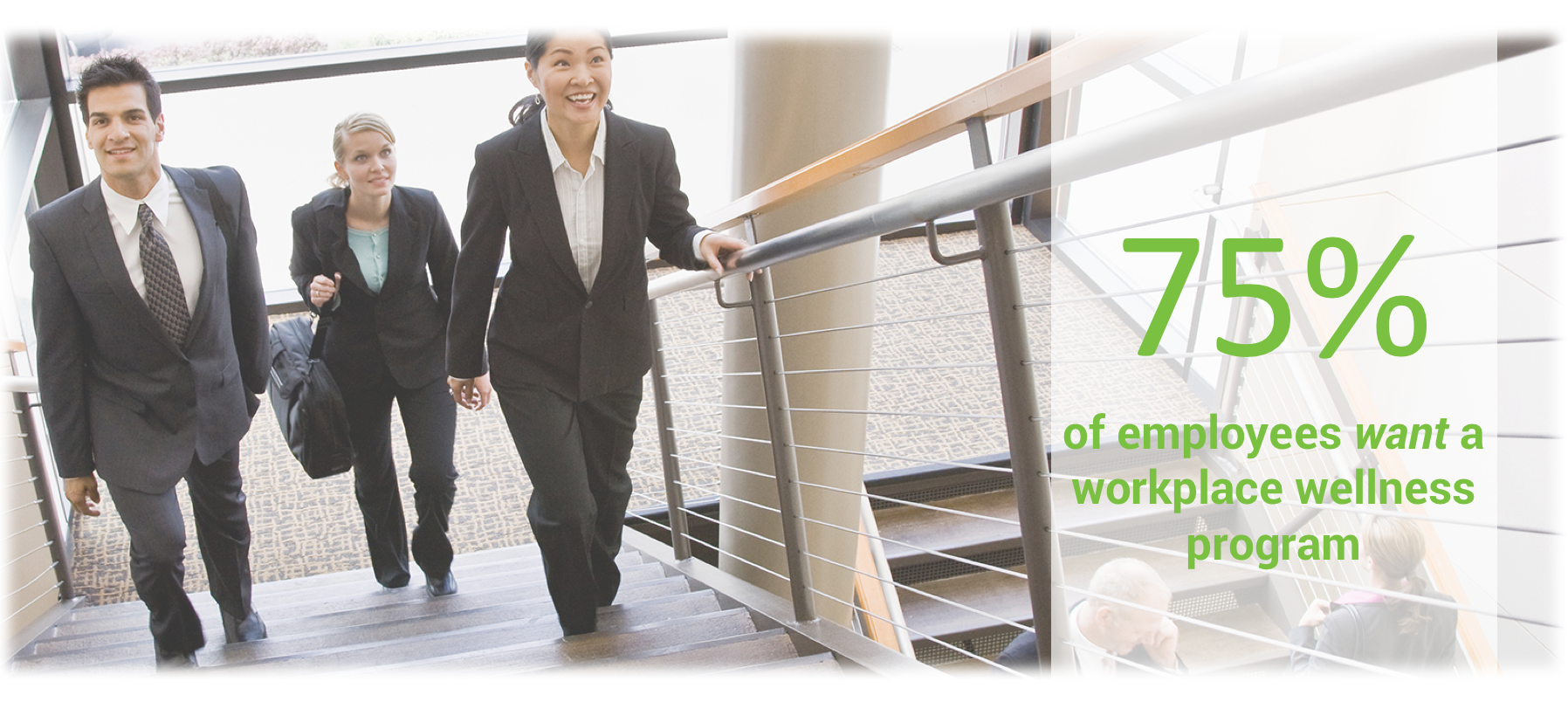 Three business professionals climbing stairs in office building